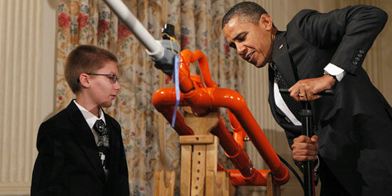 U.S. President Barack Obama launches a marshmallow from Joey Hudy's invention.