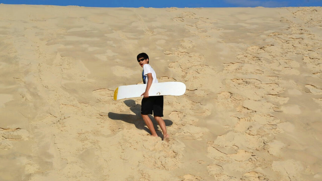 Jonathan Looi goes sandboarding in Brazil.
